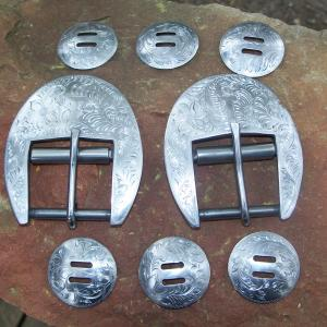 Cinch buckles and sloted conchos